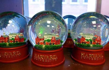 Snow globes from the Coop depicted Harvard Yard.
